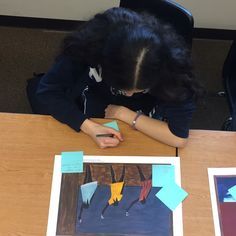 Student at work identifying the use of color, line and movement to create meaning in the Migration Series.