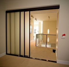 Cool frosted glass room divider with wenge finished frames.