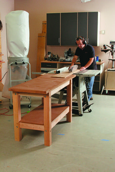 [Click for full-size]  This incredibly versatile workbench is easy to build. You can even get it to do double duty as an outfeed table. Just make it the same height as your tablesaw.  Download the free plan.