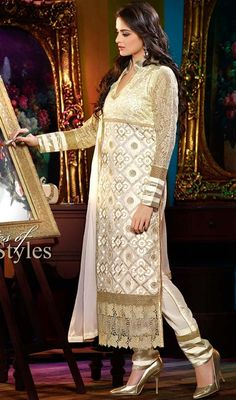 Be the instant mood brightener draped in this off white georgette embroidered salwar kameez. The floral patch, lace, resham and sequins work seems chic and best for any affair. #OffWhiteGeorgetteChuridarDress