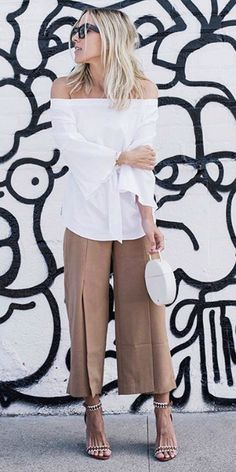 Jacey Duprie + flirty off the shoulder bell-sleeved blouse + beige pleated trousers + silver detailed stilettos   Blouse: White House Black Market. Spring Style.