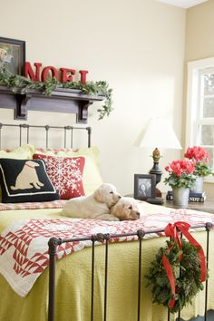 A couple of labrador puppies complete the Christmas decor in this bedroom. - Traditional Home ®