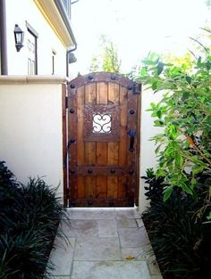 heavy wooden gates with wrought iron. Very Spanish influence