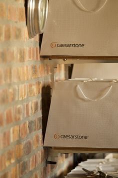 Caesarstone goodie bags worth R1 000 were arranged for guests - chocolates, gin, coffee, a KitchenAid apron, House and Leisure magazines, Nomu baking sets, Natural herb and spice grinders and Caesarstone coaster box sets were hiding inside each!