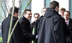 epa04676040 The Greek Premier Alexis Tsipras (2-L) arrives at a hotel in Berlin, Germany, 23 March 2015. Tsipras is scheduled to hold a meeting with German Chancellor Merkel later the day during his visit in Germany. Tsipras is expected to present a list of reforms, hoping to unlock bailout funds to prevent Greece from running out of cash next month, Greek government sources said. EPA/BRITTA PEDERSEN