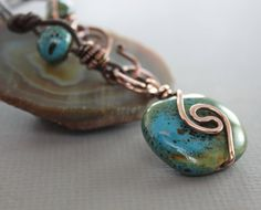 Copper necklace with olive green with hints of blue porcelain bead on chocolate brown leather cord