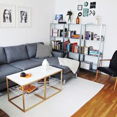 Cozy living room with Ikea 'PS 2012' side tables & 'Hyllis' shelves by @nliborius