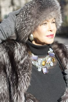 78 year old Lynn Dell ... stunning in her fur hat. This is aging gracefully. And the necklace! She looks fierce (in a good way).