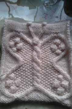 A knitted butterfly that would look good using colored yarn too