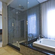 bathtub with ledge that acts as bench in shower