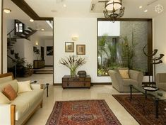 Living Room with rugs designed by Kumar Moorthy Associates. - Feste Home Decor indian home decor Living Room with rugs designed by Kumar Moorthy Associates Indian Living Rooms, Rugs In Living Room, Living Room Decor, Room Rugs, Living Room Modern, Interior Design Living Room, Living Room Designs, Drawing Room Interior, Drawing Rooms