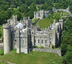 Arunel Castle in West Sussex is one of the best.   The seat of The Dukes of Norfolk and set in 40 acres of sweeping grounds and gardens,