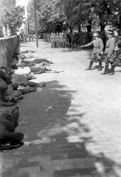 Pancevo, Serbia, A German officer confirming the death of Jewish hostages who have just been shot, by shooting them again.