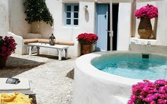 Oh man, this is a dream! So Mediterranean! What is the jacuzzi made of? traditional greek stone tile patio with jacuzzi Hotel Portugal, Patio Tiles, Jacuzzi Outdoor, Greek House, Santorini Greece, Santorini House, Imerovigli Santorini, Santorini Villas, Mykonos