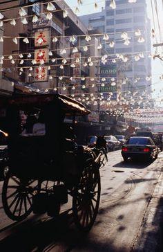 Horse drawn carriage through Chinatown in Manila.