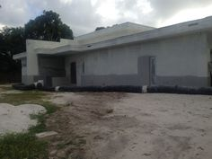 Front entry during stucco work.