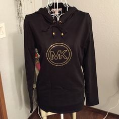 Women's Michael Kors hoodie Brand new Women's Michael Kors black hoodie with gold accents. Size small, 57% cotton, 38% polyester, 5% elastane. No trades, no lowball offers please. Michael Kors Tops Sweatshirts & Hoodies