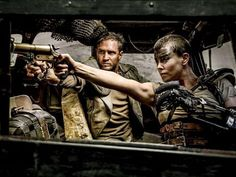 """Tom Hardy as Mad Max and Charlize Theron as Imperator Furiosa in """"Fury Road."""" Director George Miller calls the movie a """"Western on wheels. Mad Max Fury Road, David Lynch, Tom Hardy, Charlize Theron, Mulholland Drive, Grand Budapest Hotel, Lost In Translation, Mel Gibson, Christopher Nolan"""