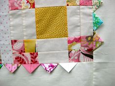 This quilt top has been made using: one and a half charm square packs of Hunky Dory by Moda for the blocks cream fabric scraps of fabric for the prairie point cut in 4 inch square polka dots fa… Quilting Tutorials, Quilting Ideas, Disappearing Nine Patch, Prairie Points, Sewing Machine Embroidery, Polka Dot Fabric, Polka Dots, Quilt Top, Fabric Scraps