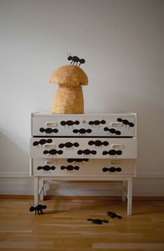"""Big, black ants in acrylic paint took over. And a chain sawn tree mushroom.""  Transformation of a bureau 