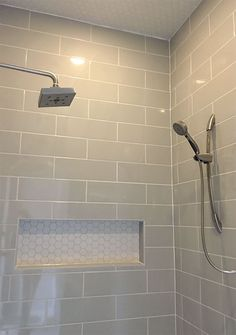 Linear light gray shower wall tile with hexagon mosaic shelf and ceiling tile | Shower Inspiration | Bathroom Ideas