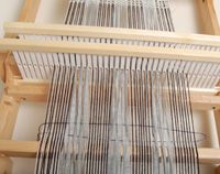 We receive frequent questions about what structures can be woven on a rigid-heddle loom. Here's Jane Patrick, former Handwoven editor and author of The Weaver's Idea Book to tell you about a technique she's been exploring to create mixed-density scarves using two rigid heddles. ––Anita  I've been weaving a lot lately with knitting yarns…