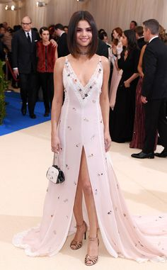 2017 Met Gala: Selena Gomez is wearing a blush pink Coach gown with lace detailing, embellishments, and a front slit. I adore this dress! The dress fits Selena beautifully! I love her new haircut!