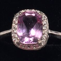🎀For Sale @blackbeards closet💖💖 🎀Vintage 925 Sterling Silver Amethyst Ring w white crystals. Weight 3.30 Gms Size Marked 925. Nonmagnetic. Note: We are not experts in any items we sell (Jewelry, Art, Designers, etc.), we may not catch every defect or deficiency, markings, title, or condition. 🎀Vintage Designer is Unknown. Neiman Marcus Jewelry Rings