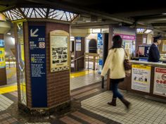 Tokyo Metro has been kind enough to preserve some of the original elements of Ginza Line's Asakusa station. Among them  the station's tiled floors and mirrored Art Deco pillars; the one here also featuring a newspaper front page from December 30, 1927, the line's (and station's) first day. Taken on March 3, 2014. © Grigoris A. Miliaresis
