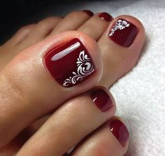Simple red /burgundy toe nails with swirl accent