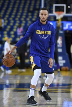 36eb5610ccb Stephen Curry of the Golden State Warriors wearing a new Under Armour  basketball show works out prior to the start of an NBA Basketball game  against.