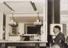 Hitler looking at his beloved architectural models, circa 1938.