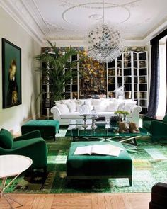 Love: Several shades of green, the intimate feeling of the artwork, the artistic chandelier juxtaposing with the more old fashioned elements. Not for me: I love fancy mouldings and trims, but this is too much for my home. I also dislike the white overstuffed sofa.