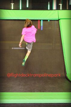 Teen walking up wall with side jump at Flight Deck Trampoline Parks