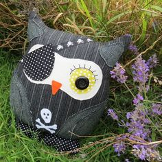This is a pinstripe pirate owl cushion. inches) The background fabric is a blended wool with a pinstripe design. His layered wings are made from a tactile tweed wool, and the skull and crossbones. Owl Cushion, Cute Cushions, Pinstriping Designs, Owl Pillow, Skull And Crossbones, Owls, Sewing Ideas, Pirates, Celebrations