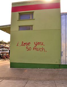"""Check out the famous """"i love you so much."""" street art on the side of Jo's Coffee located on S. Congress.  Take a pic with your loved one in front of this iconic graffiti."""