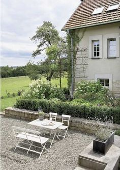 Garden Furniture On Gravel gravel patio. french style gravel patio with stone garden walls
