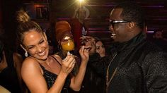 Provided by CBS Interactive Inc. J. Lo and Diddy at the AMA after party