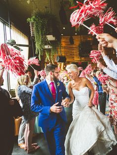Encourage nostalgia and show your school spirit by handing out cheer poms in your school (or team) colors for your wedding exit. The perfect idea for high school or college sweethearts!