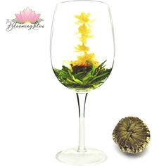 Oriental Beauty White Blooming Tea This tea is certainly an awesome combination of hand-tied White tea Maofeng with five pieces Jasmine Flower, and Marigold in the center. Flower Tea, Marigold, Teas, Jasmine, Tea Cups, Alcoholic Drinks, Oriental, Bloom, Fancy