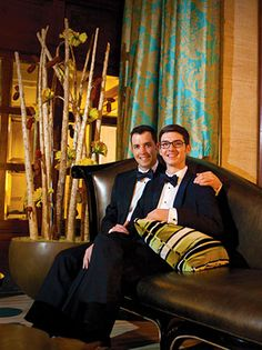The DuPont Wedding Collection - Grooms seated on leather sofa