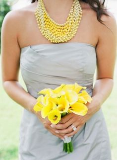 grey bridesmaids dresses with bright yellow flower bouquet + big chunky necklace