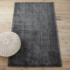 Shop scatter grey rug.   On-trend color, texture and intricate design details make this rug truly one of a kind.  In a very elaborate process, rug starts as a white base woven on a traditional loom.