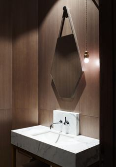 marble, mirror + pendant light