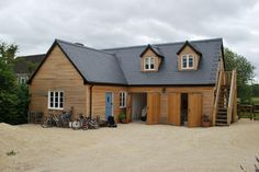 Sylva Group tells how its timber frame building provides dedicated work premises as well as additional living accommodation, giving a young family more space to work, rest and play at their Oxfordshire home. Style At Home, Timber Frame Homes, Shed, England, Outdoor Structures, Cabin, Landscape, House Styles, Building