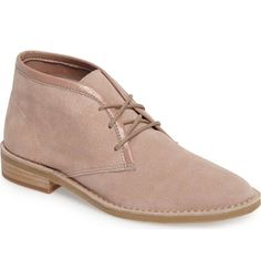 Clad in soft, lightly constructed suede, this classic chukka boot is trimmed with polished tonal leather and welted onto a traditional crepe-textured sole.