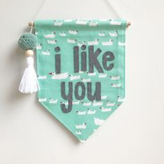"""Single sided banner made from quality cotton fabric, machine stitched on all sides. Carefully hand cut lettering - """"i like you"""" hand stit..."""