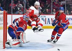 AIRTIME: Al Montoya, left, and Paul Byron, right, of the Montreal Canadiens defend the goal against Mike Green of the Detroit Red Wings on March 21 at the Bell Centre in Montreal. The Red Wings won in overtime. Nhl Season, Price Is Right, Montreal Canadiens, Detroit Red Wings, March 21, Seasons, Ottawa, Quebec, Centre
