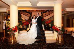 Pamela and Simon on their festive wedding day with the Ashdown Park Hotel.