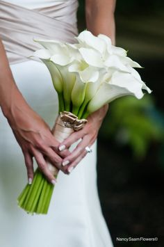 Calla lilies wrapped in a latte colored double faced ribbon, Nancy Saam Flowers Marriage and tented reception at the bride's parents Main Line home. Joanne Bening photography.